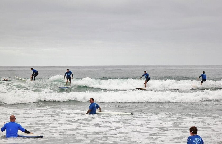 Group surfs the 100 wave challenge in 2015.