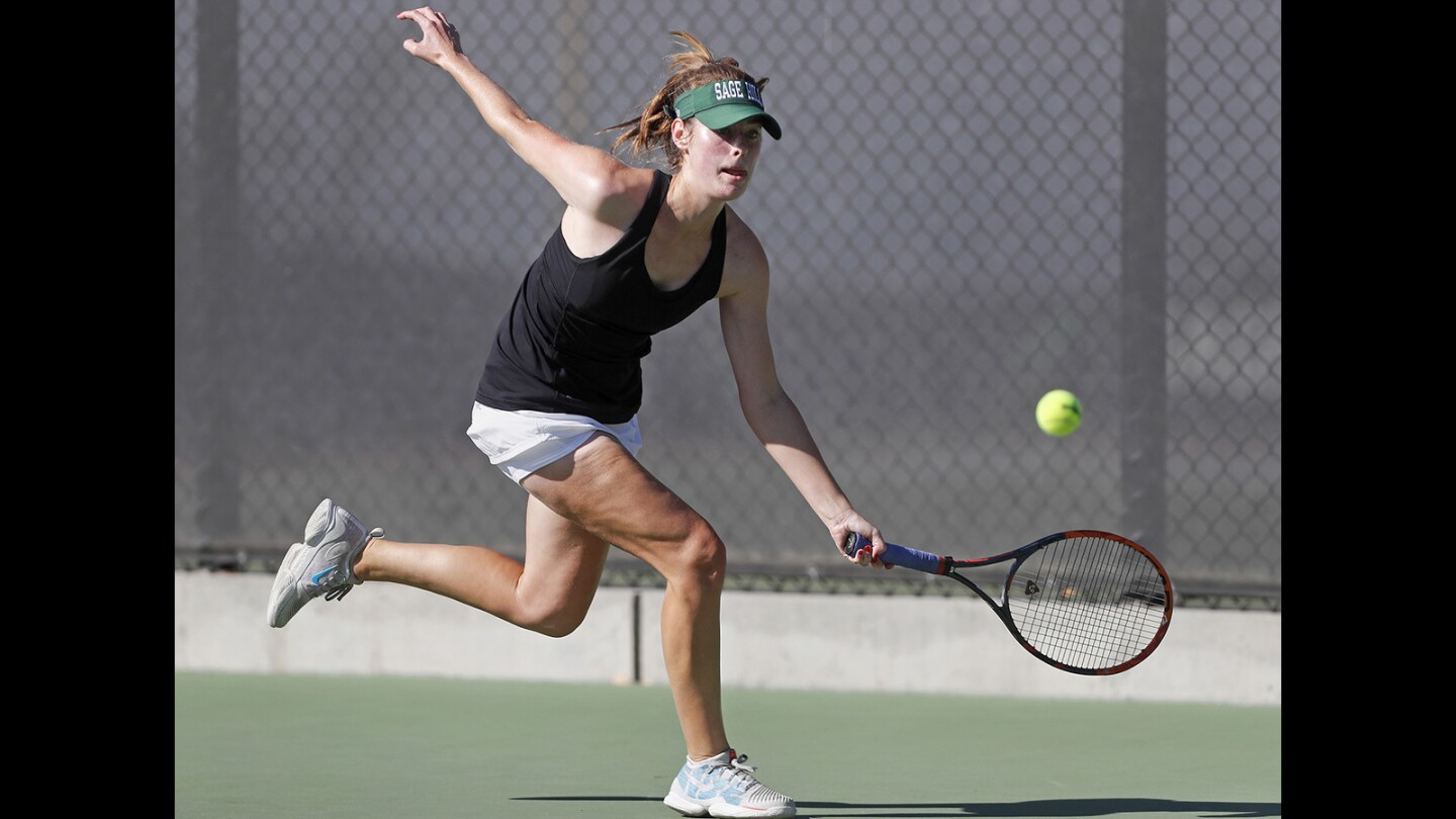 Sage Hill School's Morgan Mann competes in a No. 1 singles set against Beckman in the first round of the CIF Southern Section Division 1 playoffs in Newport Beach on Wednesday, Oct. 31.