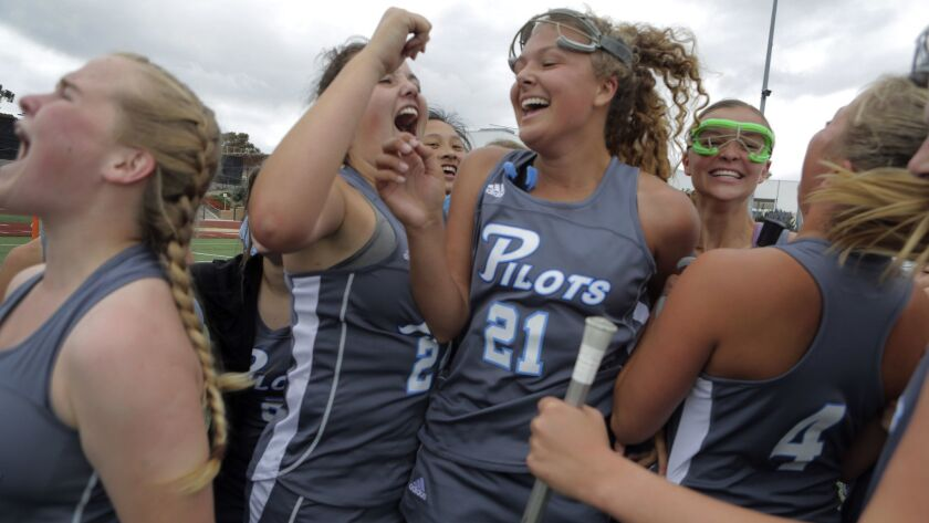 Our Lady of Peace's Allie Stowe, center left, and Bailey Gehler, center right, celebrate their win