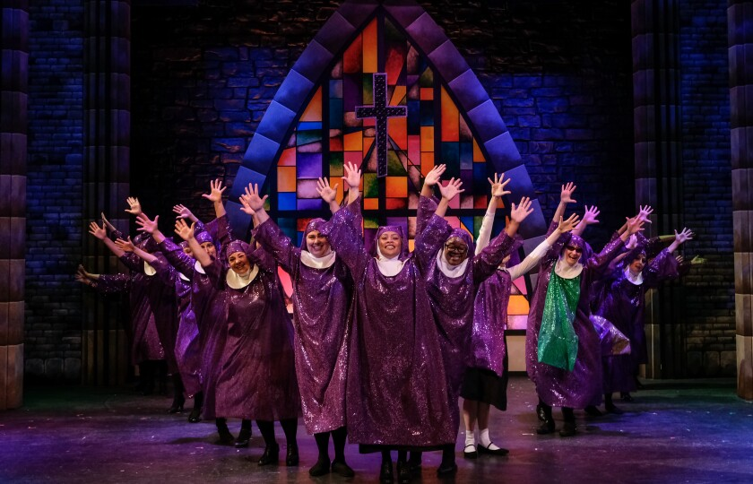 "Miriam Dance (center) and the cast of San Diego Musical Theatre's ""Sister Act."""