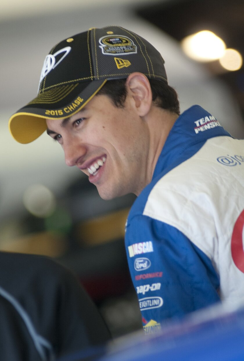 Joey Logano smiles while in the garage while waiting out a NASCAR auto race weather delay at Texas Motor Speedway Saturday, Nov. 7, 2015, in Fort Worth, Texas. The morning and afternoon Sprint Cup Series practice session were canceled. (AP Photo/Ralph Lauer)