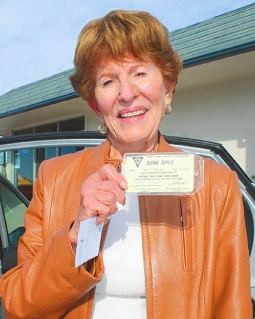Phyllis Minick shows her 1966 scuba certification card. Pat Sherman