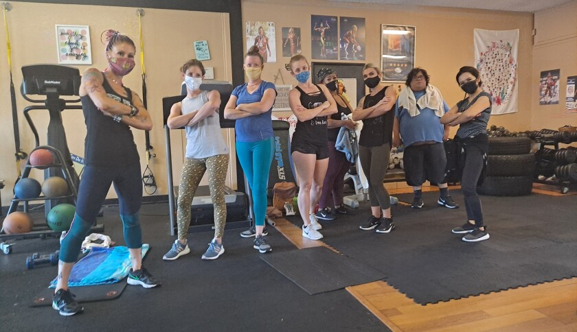 Megan Johnson-McCullough (left) and one of her classes at Every BODY's Fit in Oceanside.