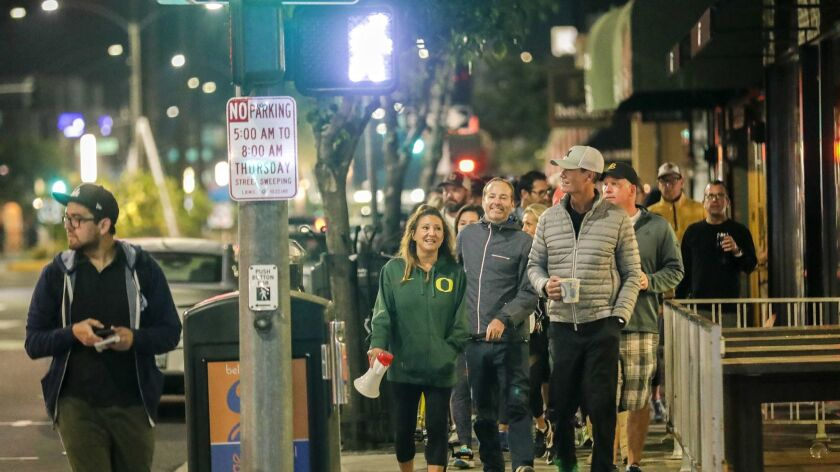 A group of Long Beach residents frustrated by crime that they believe stems from homeless encampments goes on a predawn march through the streets of the Belmont Shore neighborhood.