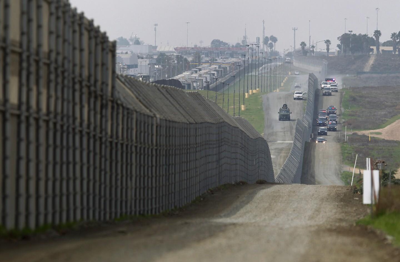 Trump visits border wall prototypes