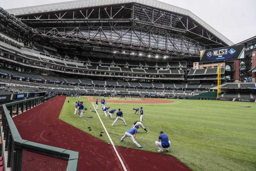 The Dodgers warm up before Game 6 of the NLCS at Globe Life Field.