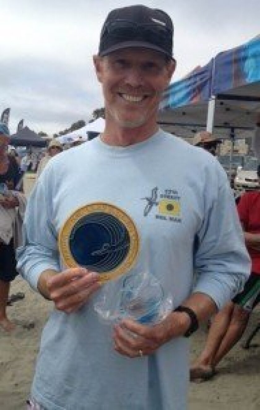 Dr. Chris Lafferty with his award for winning the 2013 World Bodysurfing Championship in the Men's 55-64 age division. Courtesy photo