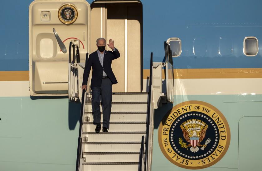 President Biden disembarks Air Force One after landing at Long Beach Airport.