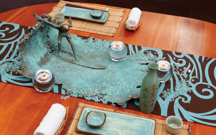 """Matthew Antichevich's """"Vertical Wave"""" sculpture adorns a sushi party table in """"Living Coastal."""""""