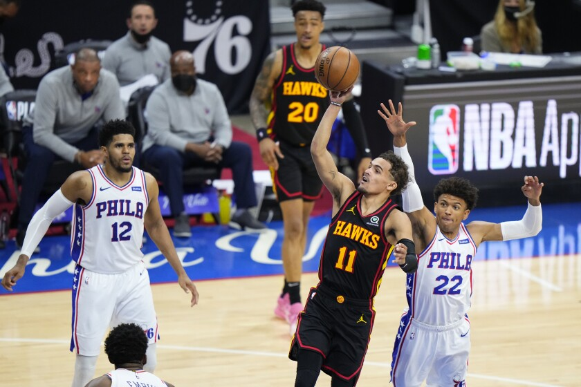 Atlanta's Trae Young  shoots in front of  Philadelphia's Matisse Thybulle during the second half.