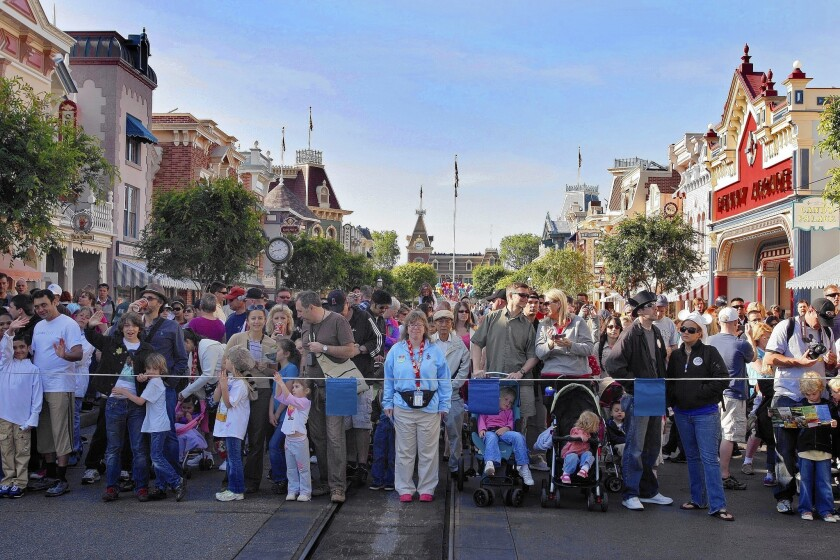 Disneyland opens the park gates to the crowds waiting on Main Street U.S.A. Crowding is causing headaches for guests and park officials.
