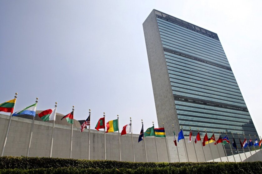 FILE - In this Sept. 13, 2005, file photo, the flags of member nations fly outside the General Assembly building at the United Nations headquarters in New York. Nearly a quarter of U.N. member states are urging that the next secretary-general, for the first time, be a woman. It's the latest sign of