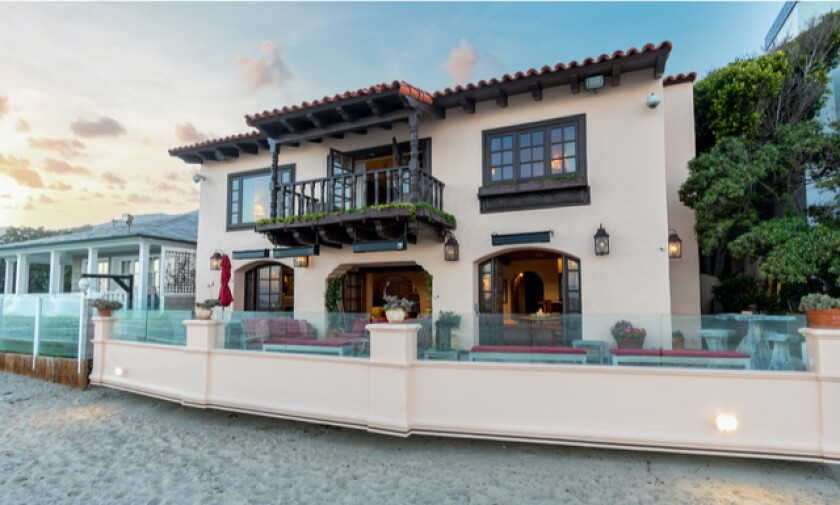 The Billionaires' Beach villa leads onto the sand.