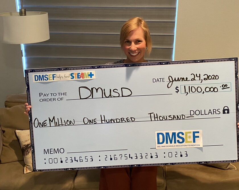 Del Mar Schools Education Foundation President Phoebe Katsell presented the school district with a check for $1.1 million.