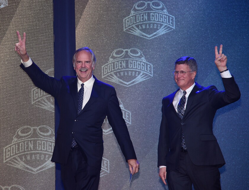From left, John Naber and Bruce Furniss announce the winner of Relay Performance of the Year during the 2017 USA Swimming Golden Goggle Awards  at L.A. Live on November 19, 2017, in Los Angeles.