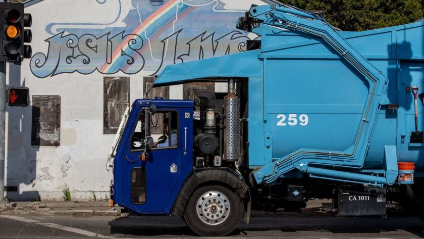 A trash truck from Rainbow Environmental Services passes the former Japanese Presbyterian church on Nichols Lane in Huntington Beach.
