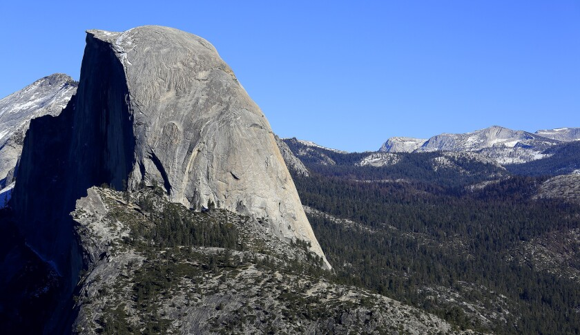 Little snow can be seen on Half Dome in a view from Glacier Point in January.