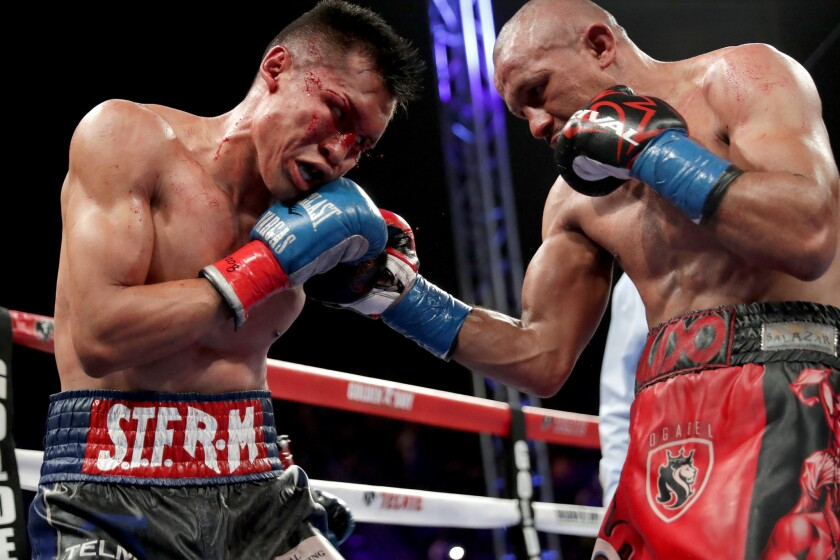 Orlando Salido, right, throws a punch at Francisco Vargas during their WBC super-featherweight championship bout at StubHub Center on June 4.