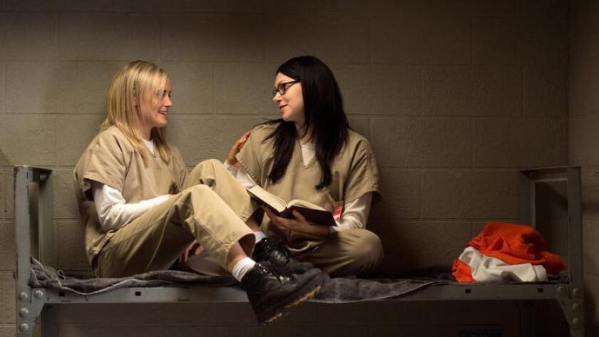"Taylor Schilling, left, and Laura Prepono in season 3 of Netflix's ""Orange is the New Black."" (JoJo Whilden)"