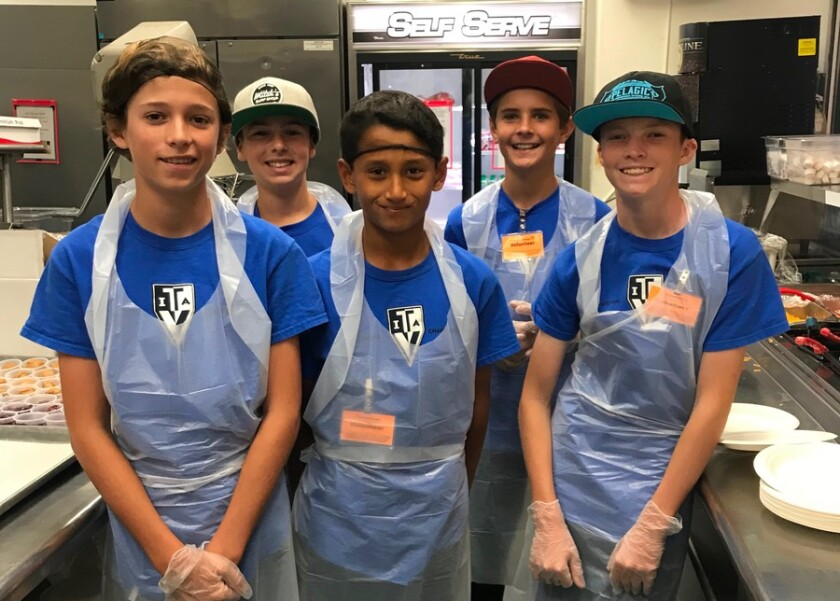 Teen Volunteers In Action spend some time serving food at Father Joe's Villages.