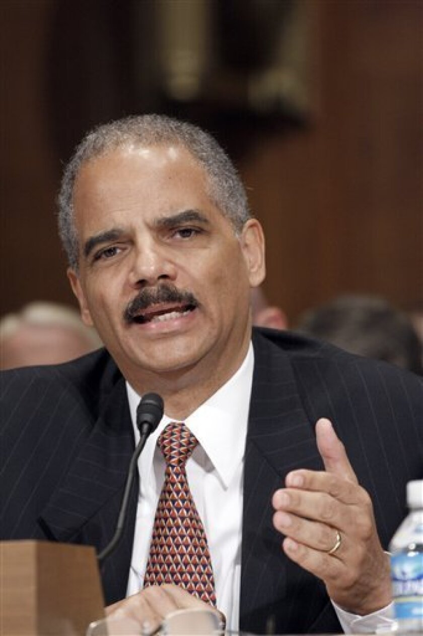 FILE - In this June 25, 2009 file photo, Attorney General Eric Holder testifies on Capitol Hill in Washington. On Thursday, July 2, 2009, Holder is having emergency oral surgery to remove a tooth he cracked. (AP Photo/Harry Hamburg, FILE)