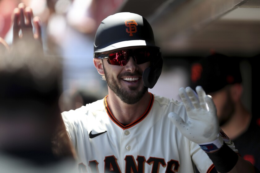 San Francisco Giants' Kris Bryant is congratulated by teammates after hitting a home run against the Houston Astros during the third inning of a baseball game in San Francisco, Sunday, Aug. 1, 2021. (AP Photo/Jed Jacobsohn)