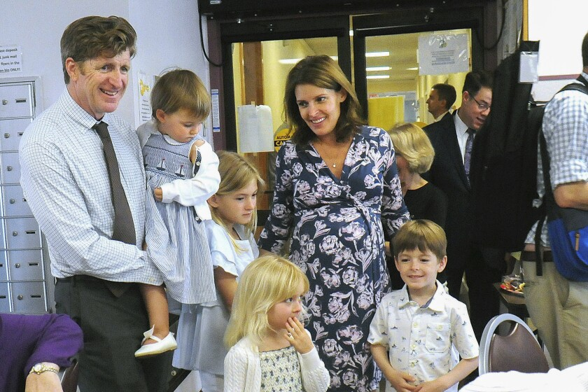 FILE - In this May 4, 2018 file photo, Amy Kennedy, right, joins her husband, former Rhode Island Congressman Patrick J. Kennedy, left, as they introduce their children to seniors at John F. Kennedy Manor in Woonsocket, R.I. Amy Kennedy will run as a Democrat against party-switching Republican U.S. Rep. Jeff Van Drew in New Jersey. (Ernest A. Brown /The Call via AP, FILE)
