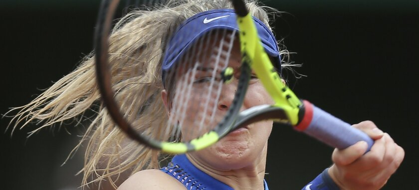 Canada's Eugenie Bouchard returns in her second round match of the French Open tennis tournament against Timea Bacsinszky of Switzerland at the Roland Garros stadium in Paris, France, Thursday, May 26, 2016. (AP Photo/David Vincent)