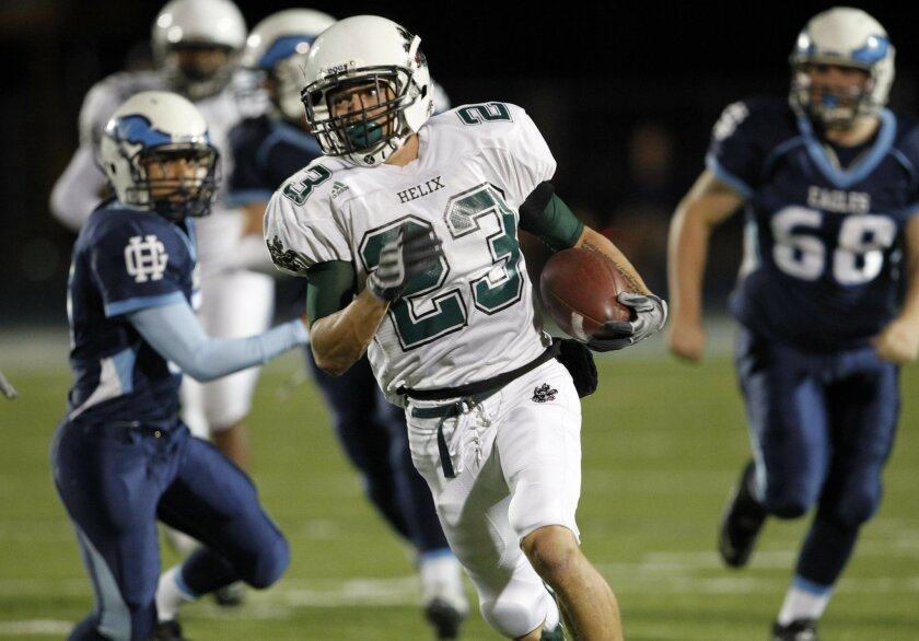 Helix receiver Austin Gonzalez charges ahead for yardage in the Highlanders' win over Granite Hills.