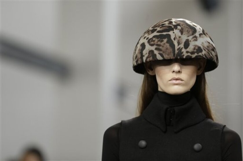 A model wears a creation for Mila Schon women's Fall-Winter 2013-14 collection, part of the Milan Fashion Week, unveiled in Milan, Italy, Wednesday, Feb. 20, 2013. (AP Photo/Luca Bruno)