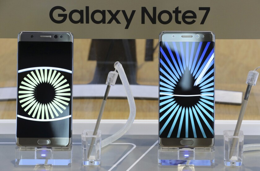 Samsung Electronics Galaxy Note 7 smartphones are displayed Tuesday at its shop in Seoul. A recall of the devices will cost the South Korean tech giant at least $5.3 billion.