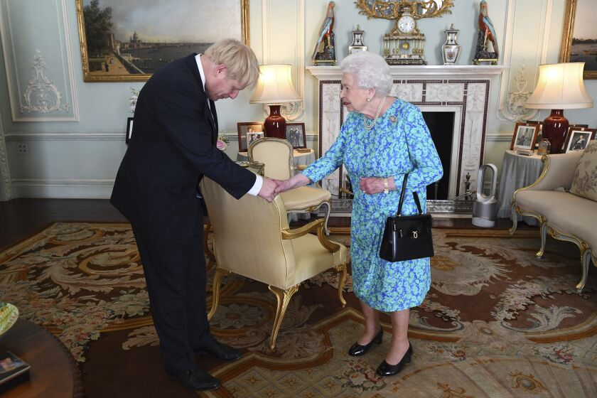 Britain's Queen Elizabeth II welcomes newly elected leader of the Conservative party Boris Johnson.