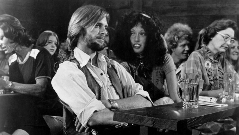 "Keith Carradine and Shelly Duvall in the 1975 movie ""Nashville."""