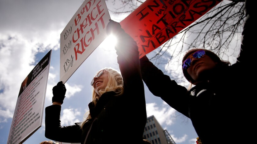 Abortion rights activists demonstrate. A new law in Utah requires doctors to provide anesthesia or painkillers to women seeking an abortion 20 weeks or more into a pregnancy. The medication is for the fetus.