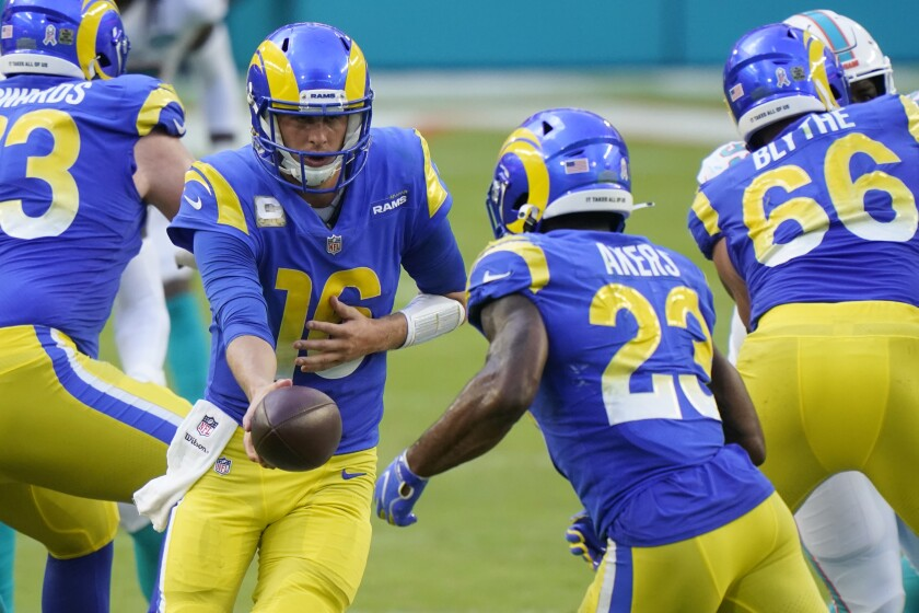 Rams quarterback Jared Goff hands the ball to running back Cam Akers.