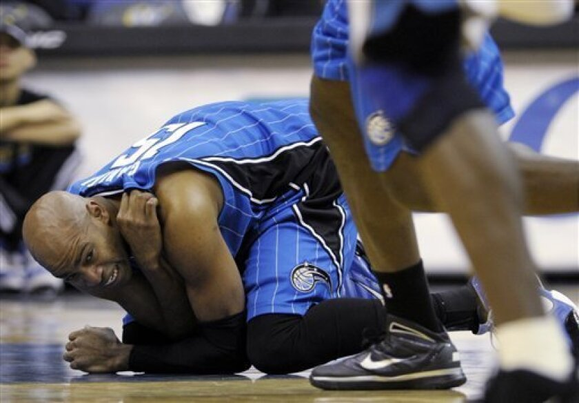 Orlando Magic guard Vince Carter reacts after getting hurt in the second quarter of the NBA basketball game against the Washington Wizards at the Verizon Center in Washington, Friday, Jan. 8, 2010. (AP Photo/Susan Walsh)
