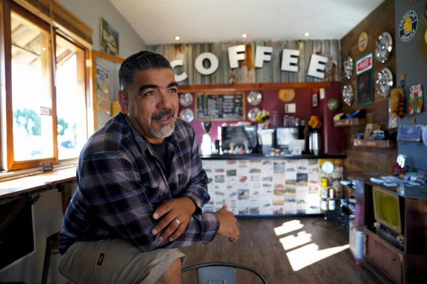 Fabian Gil a self described lowrider and business man relaxes in the Equine Vintage & Coffee shop that he recently opened in National City. Gil has strong beliefs in being a small business owner in his local neighborhoods. As well as National City he is also a small business owner in Paradise Hills of San Diego where he grew up.
