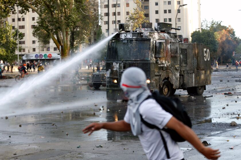 Authorities spray water at protesters in Santiago, Chile.