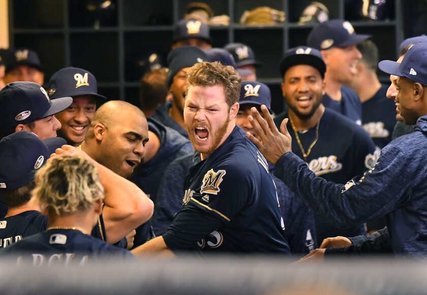 Milwaukee Brewers pitcher Brandon Woodruff celebrates his solo home run against the Dodgers in Game 1 of the NLCS at Miller Park in Milwaukee on Friday.