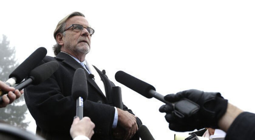John Henry Browne, a civilian attorney for U.S. Army Staff Sgt. Robert Bales, talks to reporters after Bales' arraignment at Joint Base Lewis McChord in Washington state.