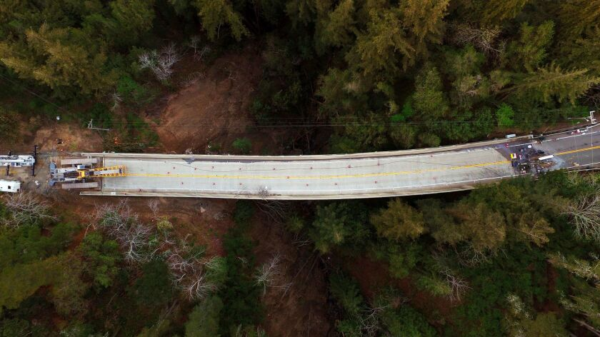 The Pfeiffer Canyon Bridge on Highway 1 buckled and slid because of heavy rains in mid-February. The bridge, shown here March 8, has left a gap in the roadway until a replacement bridge can be built.