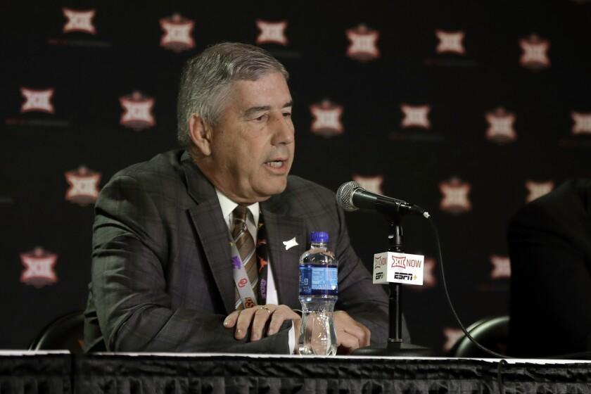 Big 12 commissioner Bob Bowlsby talks to the media.