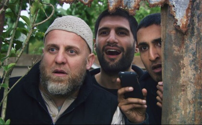 """In this film publicity image released by Drafthouse Films, from left, Nigel Lindsay, Kayvan Novak and Arsher Ali are shown in a scene from """"Four Lions."""" (AP Photo/Drafthouse Films)"""
