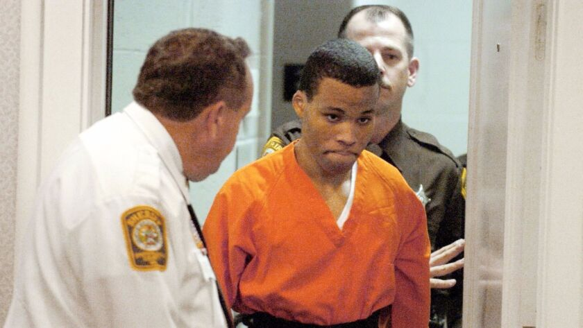 FILE - In this Oct. 26, 2004, file photo, Lee Boyd Malvo enters a courtroom in the Spotsylvania, Va.