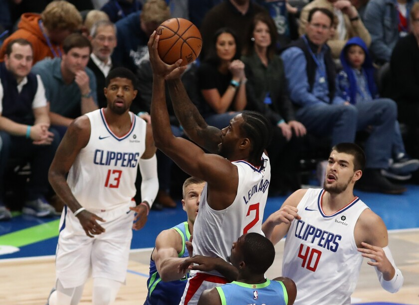 Clippers forward Kawhi Leonard puts up a shot during a 114-99 victory over the Dallas Mavericks on Tuesday.
