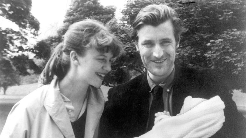 Sylvia Plath and Ted Hughes with one of their children.