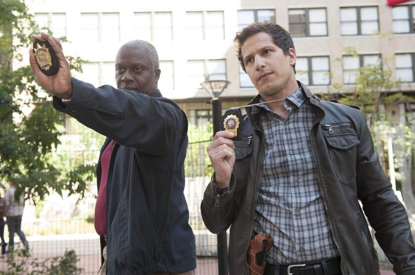 """Capt. Ray Holt (Andre Braugher, left) and Det. Jake Peralta (Andy Samberg) chase down a graffiti tagger in """"Brooklyn Nine-Nine."""""""