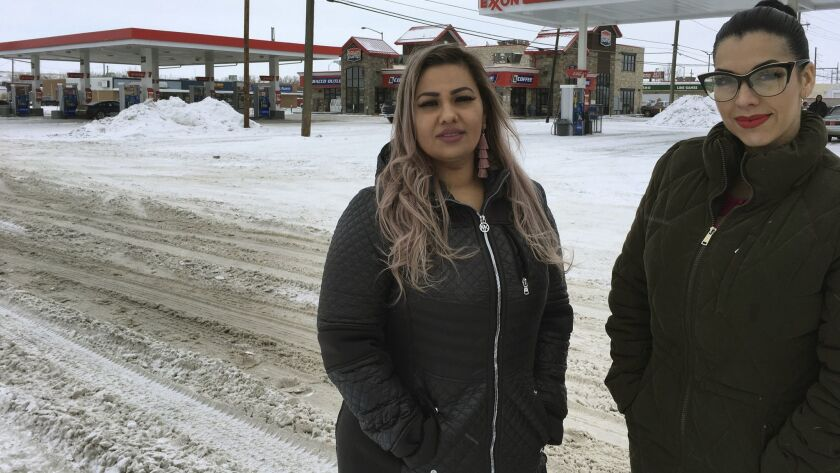 In this Wednesday, Jan. 23, 2019, photo provided by the ACLU of Montana, Martha Hernandez, left, and
