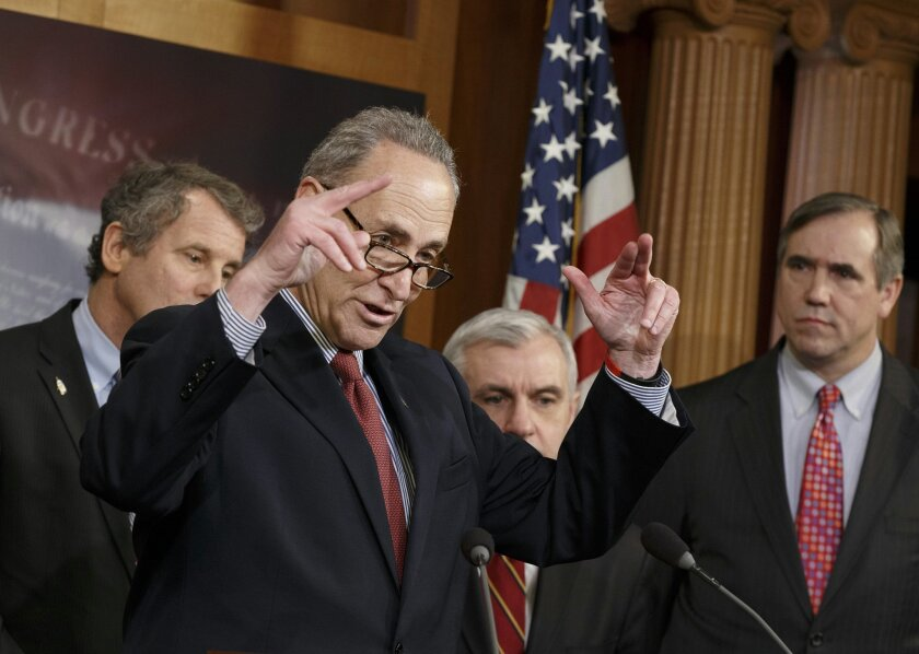 Sen. Charles Schumer, D-N.Y., second from left, gestures during a news conference on Capitol Hill in Washington, Tuesday, Jan. 7, 2014, after legislation to renew jobless benefits for the long-term unemployed unexpectedly cleared an initial Senate hurdle. From left are, Sen. Sherrod Brown, D-Ohio, Schumer, Sen. Jack Reed, D-R.I., and Sen. Jeff Merkley, D-Ore. The vote was 60-37 to limit debate on the legislation, with a half-dozen Republicans siding with the Democrats on the test vote. Sen. Jack Reed, D-R.I., along with Republican Sen. Dean Heller of Nevada, led the effort to reauthorize the benefits for three months which expired on Dec. 28. (AP Photo/J. Scott Applewhite)