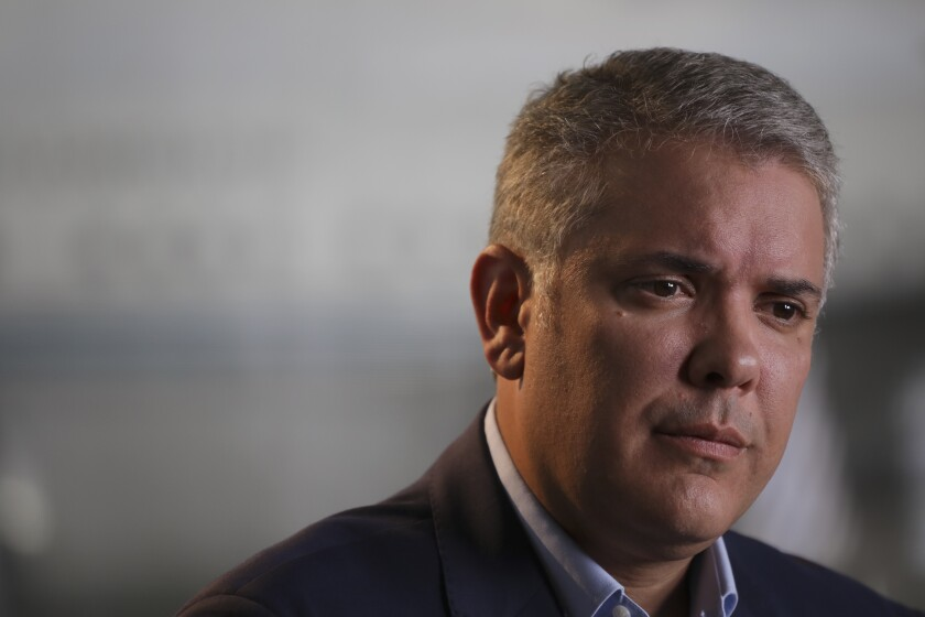 Colombia's President Ivan Duque listens to questions during an interview with The Associated Press at the CATAM air base in Bogota, Colombia, Saturday, Sept. 21, 2019. Duque's will speak before the United Nations General Assembly and is expected to condemn Venezuelan leader Nicolás Maduro as an abusive autocrat who is not only responsible for the country's humanitarian catastrophe but is also now a threat to regional stability for his alleged harboring of rebels labeled a terrorist group by the U.S. and European Union. (AP Photo/Ivan Valencia)
